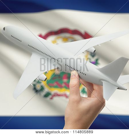 Airplane In Hand With Us State Flag On Background - West Virginia