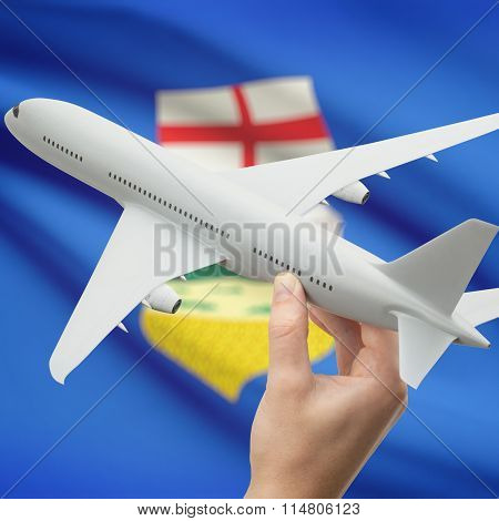Airplane In Hand With Canadian Province Flag On Background - Alberta