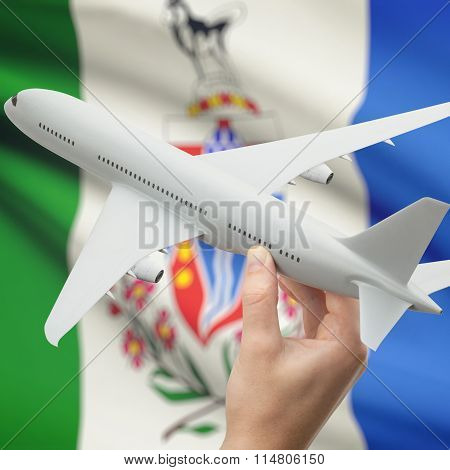 Airplane In Hand With Canadian Province Flag On Background - Yukon