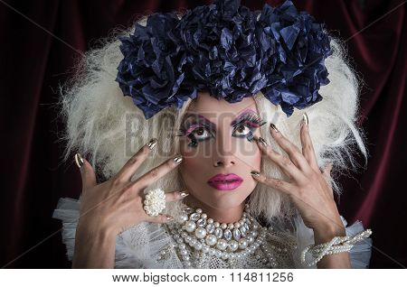 Drag queen with spectacular makeup, glamorous trashy look, posing while using hands and fingers. poster