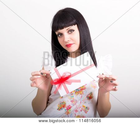beautiful girl with an envelope tied with ribbon