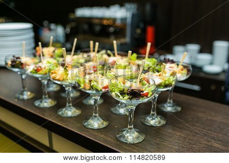 Beautifully Decorated Catering Banquet Table With Different Food Snacks In A Glass On Corporate Even