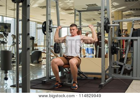 Strong guy with barbell.