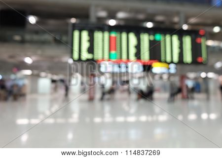 Blur Photo of passenger see the flight information displays in  Airport