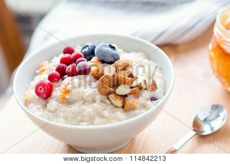 Porridge oats in bowl with berries and nuts