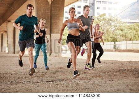 Group Of Athletes Sprinting