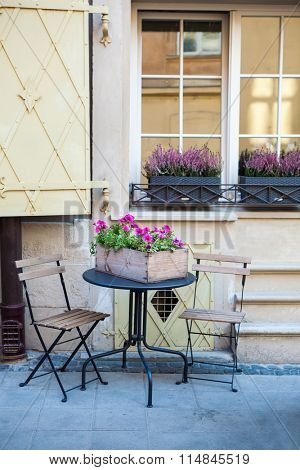 Romantic french style street decor with lavender flowers, table and chairs