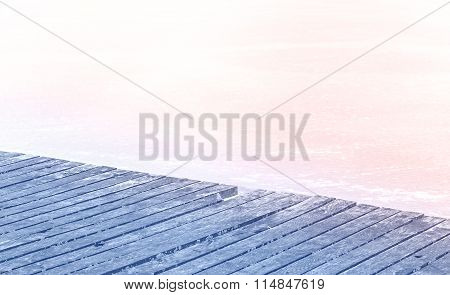 Rose Quartz And Serenity Colors Stylized Wooden Pier On Frozen Lake.