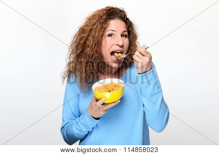 Vivacious Young Woman Eating Breakfast Cereal