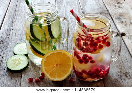 Detox water in mason jar glasses against rustic wood