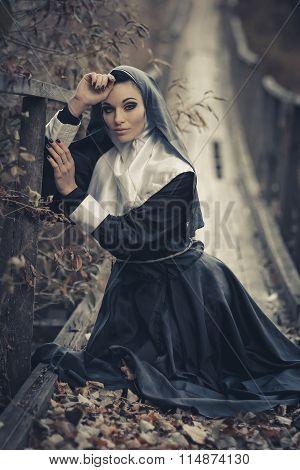 Very creative shooting. Beautiful nun, sexy nun, young nun, beautiful nun, fashionable nun, glamorous nun, religious nun, top nun, best nun, guilty nun, believer nun, nun is kneeling on suspension bridge,pray.