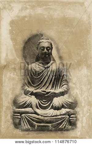 Vintage aged seated Buddha statue on a light colored textured grunge background with copy space above