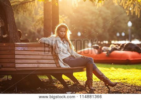beautiful young blond girl in a park