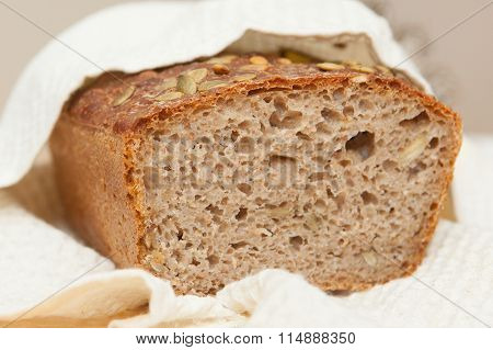 Sour Dough  Home Baked Whole Grain Loaf Of Bread.