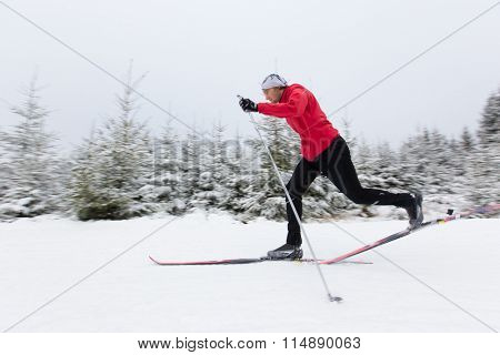 Young man cross-country skiing. Winter sport.