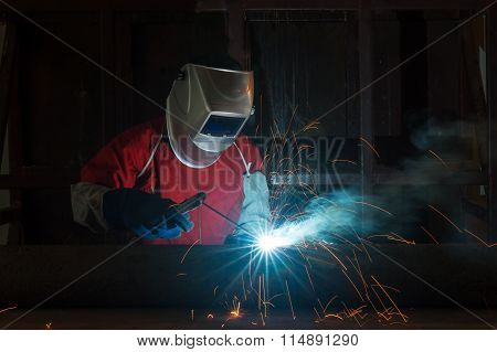 Worker With Protective Mask Welding Metal In Factory