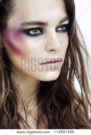 young beauty woman with makeup like shiner on face close up isolated white background