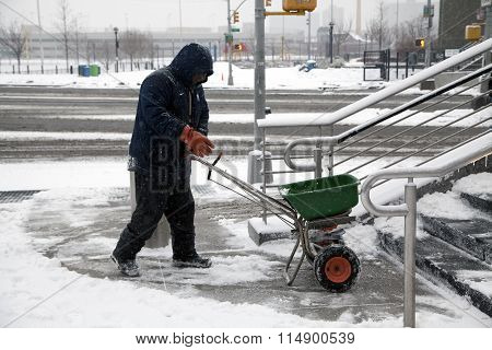 Man Spreads Salt During Snow
