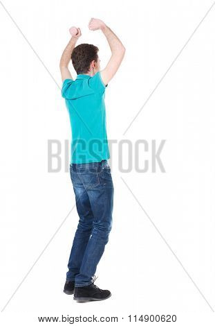 Back view of  man.  Raised his fist up in victory sign.   Rear view people collection.  backside view of person.  Isolated over white background. Guy happily he raised both arms above his head.