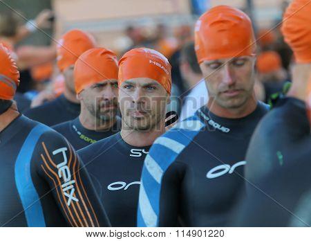 Triathlete Wearing Orange Bathing Cup Walking To The Start Area