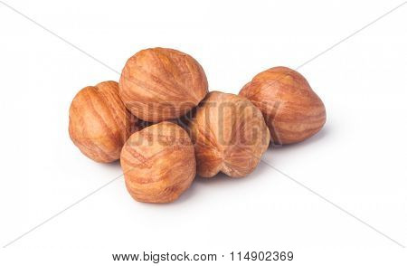 Closeup view of hazelnuts isolated on white background