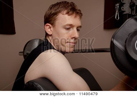 Young man performs bicep curl