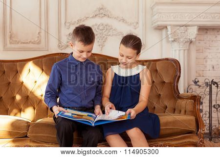 Two children reading book