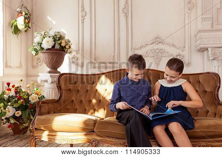 Smiling girl and boy reading book