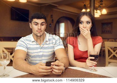 Shocked Girl Spying Boyfriend on Smartphone