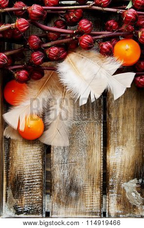 Exotic fruits flowers with candles and feathers