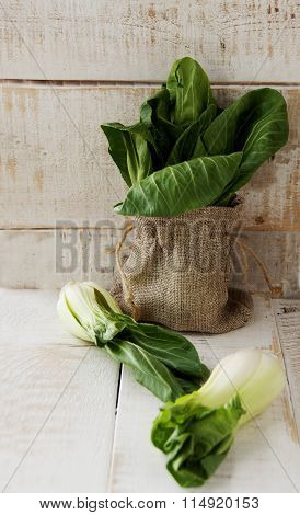 baby bok choy on a wooden table