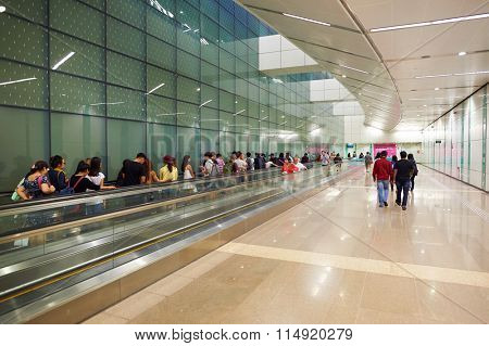 SINGAPORE - NOVEMBER 07, 2015: interior of MRT station. MRT is a rapid transit system forming the major component of the railway system in Singapore, spanning the entire city-state
