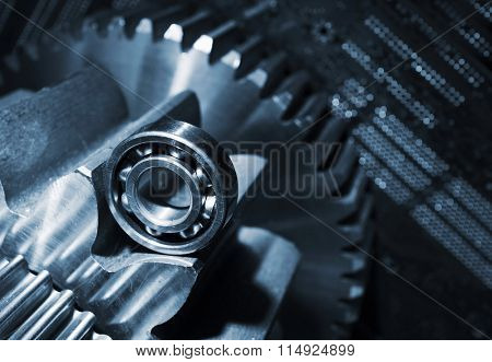 cogwheels and gears against a computers circuitboard, computer calibrations