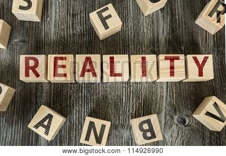 Wooden Blocks with the text: Reality