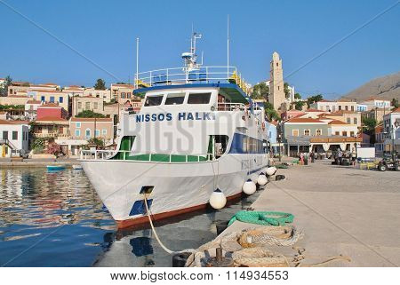 HALKI, GREECE - JUNE 17, 2015: Passenger ferry Nissos Halki moored at Emborio on the Greek island of Halki. The 29mtr vessel operates between Kamiros Skala harbour on Rhodes and Halki island.