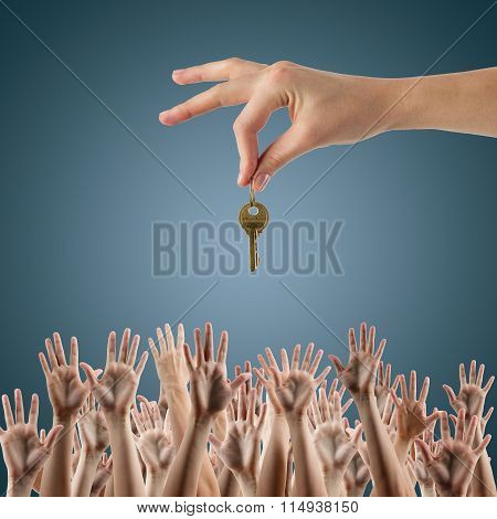 REAL ESTATE concept. Many hands want to get the key