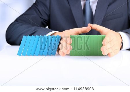 Planning, Risk And Strategy In Business, Businessman  Holding   Wooden Blocks.  Businessman Stopping
