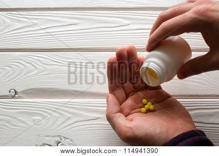man takes ascorbic acid on a white background poster