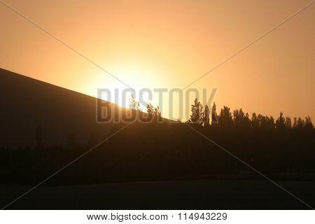 Sunset in Mingsha Shan (Echo Sand Mountain) Dunhuang China