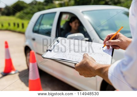 young female learner driver driving test