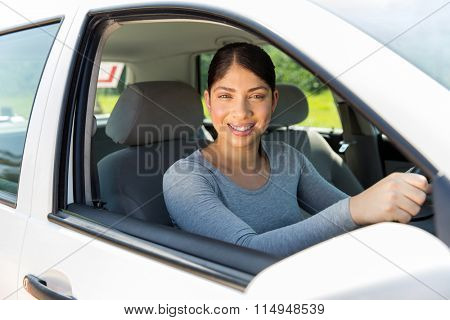 pretty female learner driver looking out of the car window