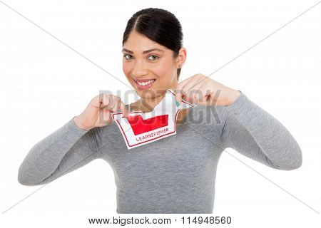 beautiful young woman tearing up learner driver sign on white background