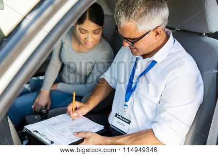 portrait of senior driving instructor and student driver during lesson