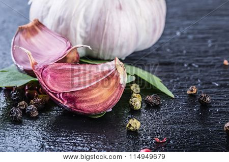 Garlic. Fresh Garlic. Cloves of garlic with parsley herb top leaves and pepper four colours