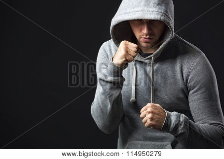 Portrait Of Brutal Looking Young Guy Ready To Fight.