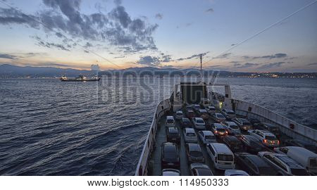 Full Ferry Crossing The Channel At Sunset