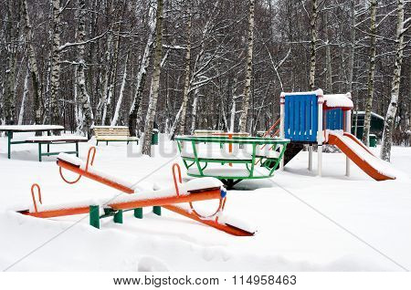 Children Playground In Snow Horizontal