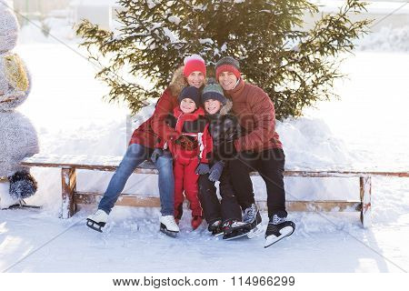 Happy Family Skate In The Winter