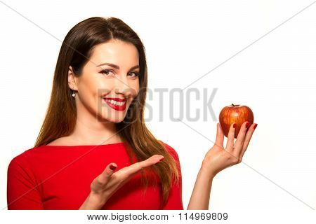 Positive Female Biting A Big Red Apple Fruit Smiling On White Background Pointing