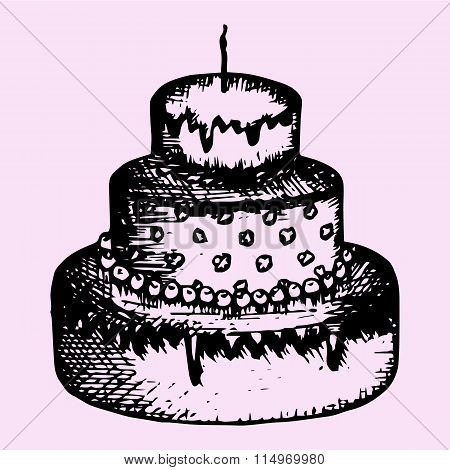 three-tiered cake with candle